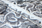 Aerial view of forest river in winter and railroad — Stock Photo