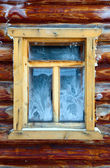 Close up of window in log house — Stock Photo