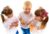 Smiling children with a glass of juice — Stock Photo