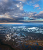 Aerial view of vast swamps under clouds — Stock Photo