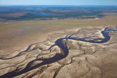 Aerial view of a river running on vast plains — Stock Photo