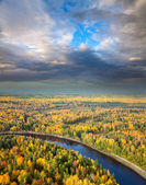 Fores river under evening clouds — Stock Photo