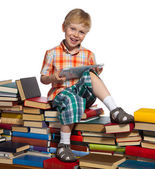 Little boy on a pile of books — Stock Photo