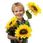 Happy boy with sunflowers — Stock Photo