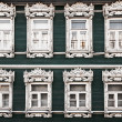 Windows of old, wooden house in traditional russian style — Stock Photo #40175999