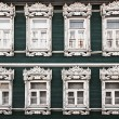 Windows of old, wooden house in traditional russian style — Stock Photo