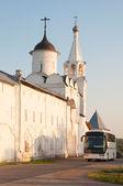 Tourist bus near the monastery walls. Russia — Stock Photo