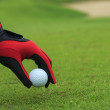 Foto Stock: Hand hold golf ball