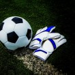 Soccer ball and gloves — Stock Photo