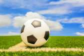Football with blue sky — Stock Photo