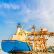 Stock Photo: Cargo ship loading containers