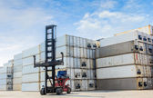 Forklift handling containers box at work — Stockfoto
