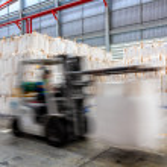 Forklift loader in warehouse — Stock Photo