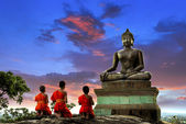 Buddha statue and Novice at sunset  — Stock Photo
