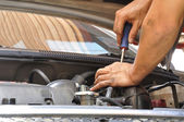 Mechanic doing unscrew — Stock Photo