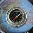 Compass on world map background — Stock Photo #33467477
