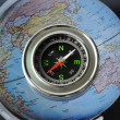 Compass on world map background — Stock Photo