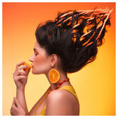 Young beautiful girl with a fashionable hairstyle, earrings and — Stock Photo