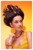 Beautiful young girl with a fashionable haircut, earrings in the — Stock Photo
