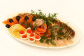 Assorted fish herring, salmon, red caviar, decorated with lemon, — Stock Photo