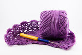 Skein of cotton thread and an openwork pattern,  crocheted — Stock Photo
