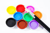 Paints pots and paintbrushes — Stock Photo