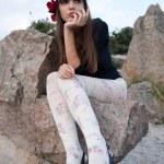 Girl posing on the rocks — Stock Photo #42924623