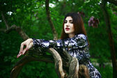 Armenian fashion girl in lilac flowers — Stockfoto