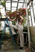 Brunette woman  in azalea garden — Stock Photo