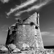 Stock Photo: Ancient watch tower on coastline of southern Italy