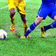 Stock Photo: Soccer player leg in action