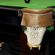 Black billiard ball in front of corner pocket on green baize table — Stock Photo