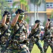 KUANTAN, MALAYSIA - AUG 31: Malaysia Army demonstrate a hand combat defending at National Day parade, celebrating the 55th anniversary of independence on August 31, 2012 in Kuantan, Pahang, Malaysia. — Zdjęcie stockowe