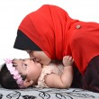 Young Asian muslim mother kissing her cute baby girl isolated on white background — Stock Photo