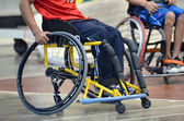 Basketball player in the wheelchair paralympic games — Stock Photo