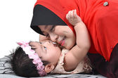 Young Asian muslim mother playing and smiling with her cute baby girl isolated on white background — Stock Photo