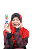 Beautiful young Asian muslim woman happy celebrate New Year 2014 isolated on white background — Zdjęcie stockowe