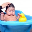 Cute Asian baby enjoying bath by her mother isolated on white background — Stock Photo #44929701