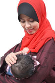 Young Asian muslim mother breastfeeding her cute baby girl isolated on white background — Stock Photo