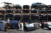 Crushed and damaged car parts at junkyard — Stock Photo