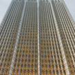 A glass wall of modern office building with a golden sheen — Stock Photo #36312013