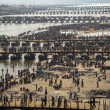 Hindu devotees crossing the pontoon bridges over the Ganges at Kumbh Mela 2013 — Stock Photo #33357675