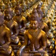 Rows of Sitting Buddha Statues at Buddhist Temple — Stock Photo