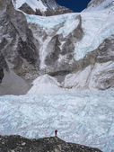 Trekker Standing in Front of the Khumbu Glacier in Nepal — Stock Photo