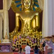 Buddhist Devotees Praying in front of Giant Buddha Statue — Stock Photo