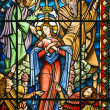 Catholic stained glass window — Stock Photo