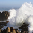 Big wave against little cape — Stock Photo