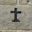 Black cross symbol engraved in granite — Stock Photo