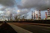 Oil refinery by night — Stock Photo