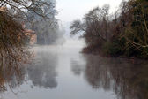 Foggy river with watemill — Stock Photo